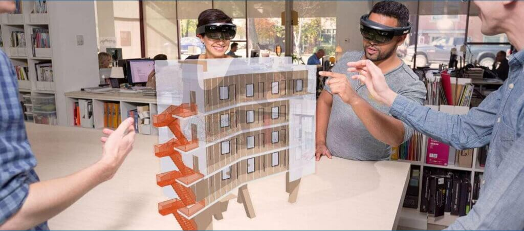 Plusieurs personnes visualisent un projet 3D SketchUp en réalité augmentée
